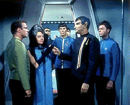 Amanda and Sarek being welcomed aboard the Enterprise